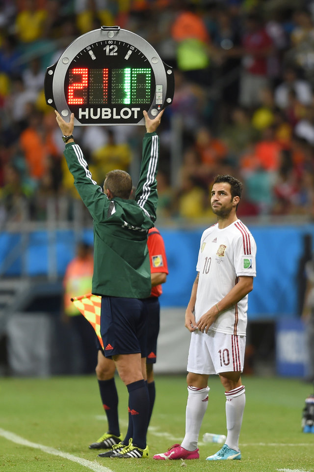 Photo - Spain's Cesc Fabregas prepares to join the game during the group B World Cup soccer match between Spain and the Netherlands at the Arena Ponte Nova in Salvador, Brazil, Friday, June 13, 2014. (AP Photo/Manu Fernandez)