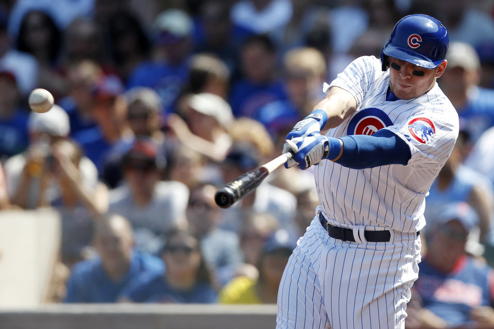Photo - Chicago Cubs' Ryan Sweeney hits a single against the Philadelphia Phillies during the first inning of a baseball game on Sunday, Sept. 1, 2013, in Chicago. (AP Photo/Andrew A. Nelles)