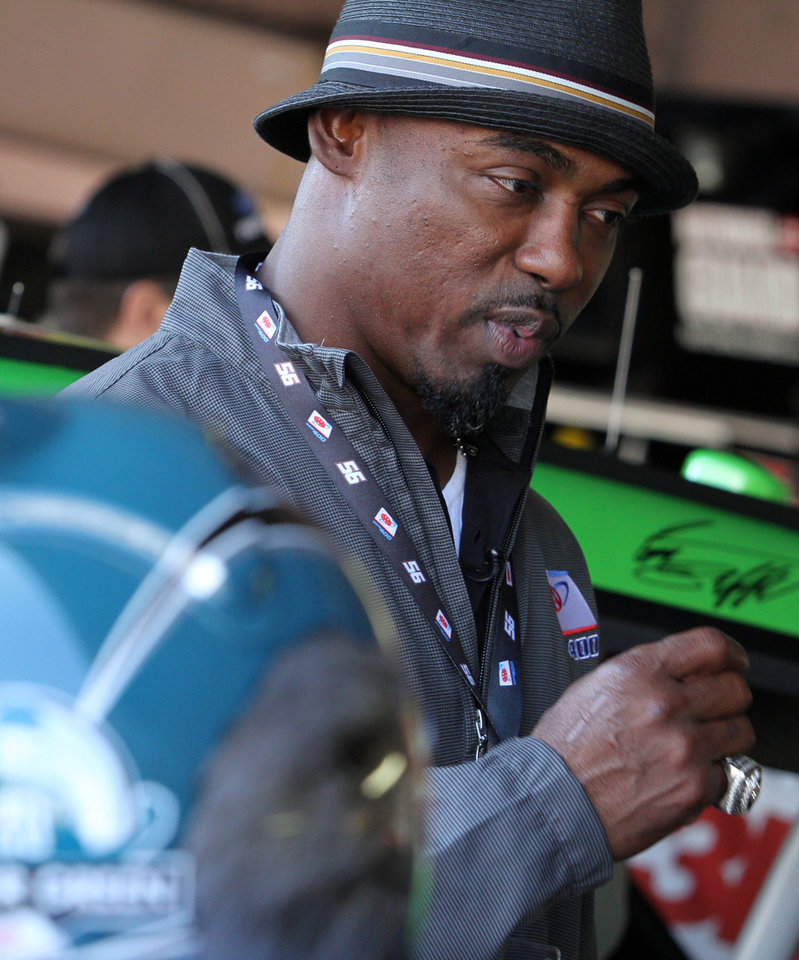 Photo -   Former Philadelphia Eagles safety Brian Dawkins, grand marshal for the race, stands in a garage before the NASCAR Sprint Cup Series auto race Sunday, Sept. 30, 2012, at Dover International Speedway in Dover, Del. (AP Photo/The News-Journal, Daniel Sato) NO SALES