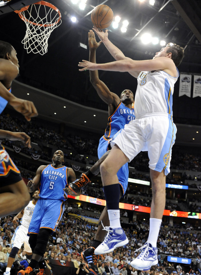 Photo - Denver Nuggets forward Danilo Gallinari (8) from Italy goes up for a shot against Oklahoma City Thunder forward Serge Ibaka (9) from the Republic of Congo during the second half of game 3 of a first-round NBA basketball playoff series Saturday, April 23, 2011, in Denver. (AP Photo/Jack Dempsey)