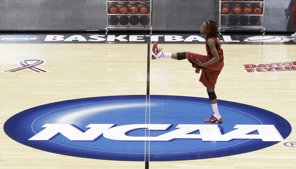 Oklahoma guard Danielle Robinson loosens up during practice for an NCAA tournament regional semi-final basketball game, Friday, March 25, 2011 in Dayton, Ohio. Oklahoma plays Notre Dame Saturday. (AP Photo/Al Behrman)