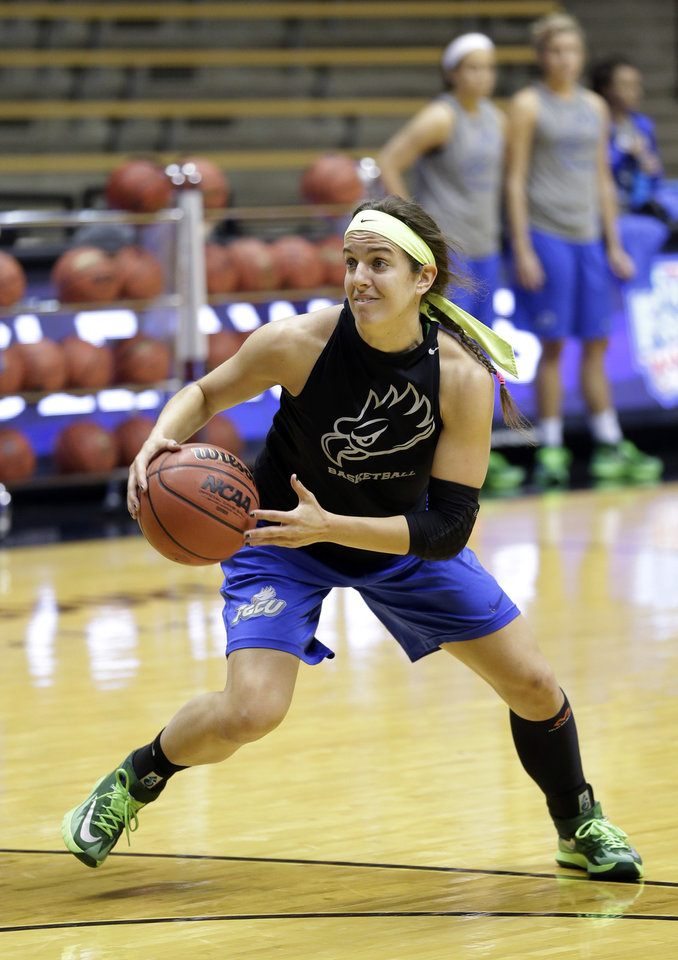Photo - Florida Gulf Coast guard Sarah Hansen dives to the bucket during practice at the NCAA women's college basketball tournament in West Lafayette, Ind., Friday, March 21, 2014.  Florida Gulf Coast plays Oklahoma State in a first-round game on Saturday.(AP Photo/Michael Conroy)