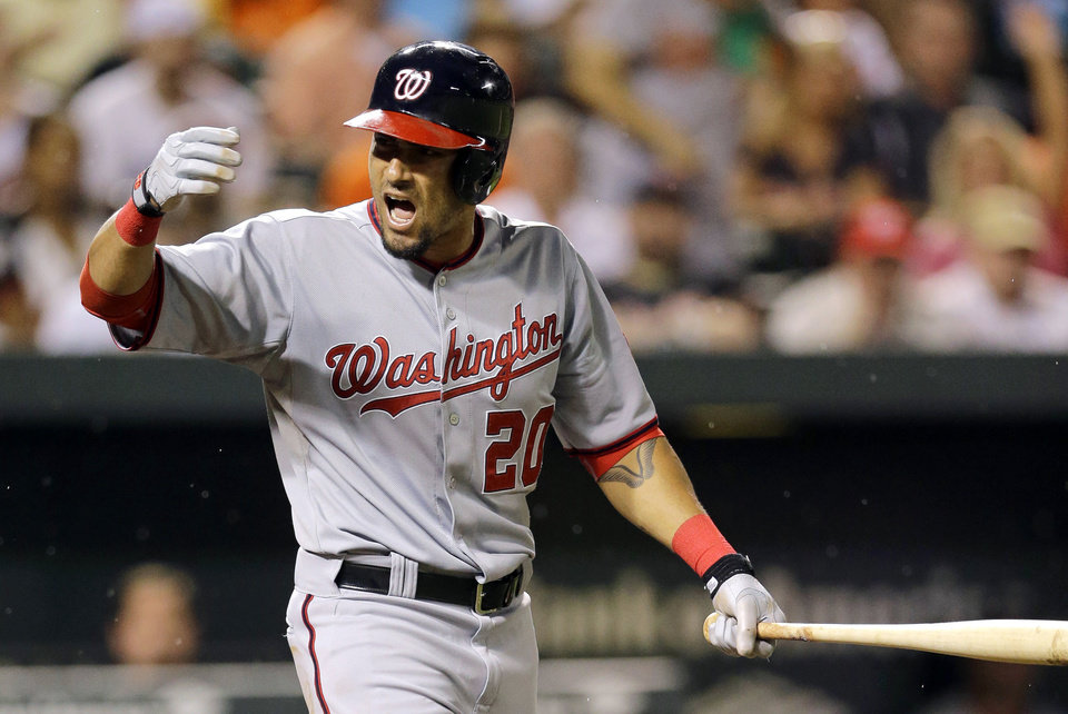 Photo - Washington Nationals' Ian Desmond reacts after his right arm was hit by a pitch thrown by Baltimore Orioles relief pitcher Darren O'Day in the eighth inning of an interleague baseball game, Thursday, July 10, 2014, in Baltimore. (AP Photo/Patrick Semansky)