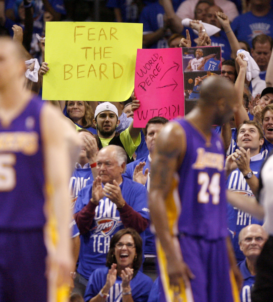 Photo - Oklahoma City fans hold up signs in support of James Harden during Game 1 in the second round of the NBA playoffs between the Oklahoma City Thunder and L.A. Lakers at Chesapeake Energy Arena in Oklahoma City, Monday, May 14, 2012. Photo by Bryan Terry, The Oklahoman