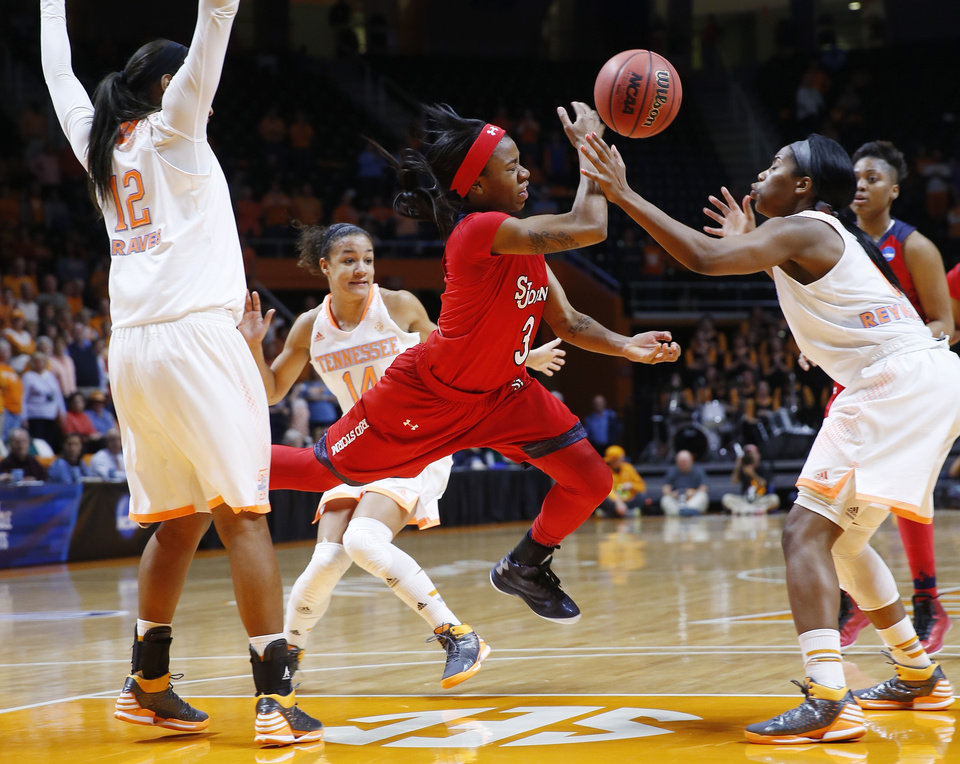 Photo - St. John's guard Aliyyah Handford (3) drives between Tennessee defenders Bashaara Graves (12), Andraya Carter (14) and Jordan Reynolds, right, in the second half of an NCAA women's college basketball second-round tournament game Monday, March 24, 2014, in Knoxville, Tenn. (AP Photo/John Bazemore)