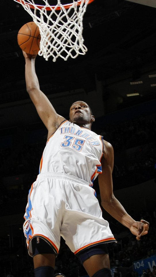 Oklahoma City's Kevin Durant (35) dunks the ball during the NBA basketball game between the Washington Wizards and the Oklahoma City Thunder at the Oklahoma City Arena in Oklahoma City, Friday, January 28, 2011. The Thunder won, 124-117, in double overtime. Photo by Nate Billings, The Oklahoman