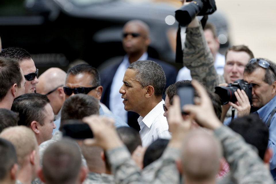President Barack Obama greets guests at Tinker Air Force Base in Midwest City, Sunday, May 26, 2013. Obama was in town to visit areas damaged by the May 20 tornado. Photo by Sarah Phipps, The Oklahoman