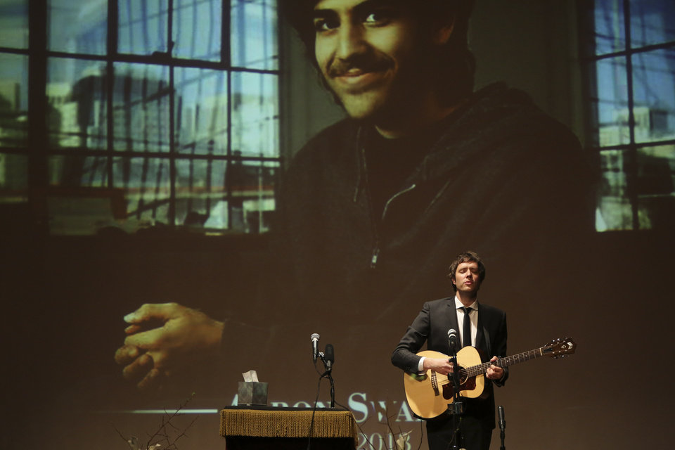 Photo - Damien Kulash, of the band OK Go, perorms during the memorial service for Aaron Swartz, Saturday, Jan. 19, 2013 in New York. Friends and supporters of Aaron Swartz paid tribute Saturday to the free-information activist and online prodigy, who killed himself last week as he faced trial on hacking charges. (AP Photo/Mary Altaffer)