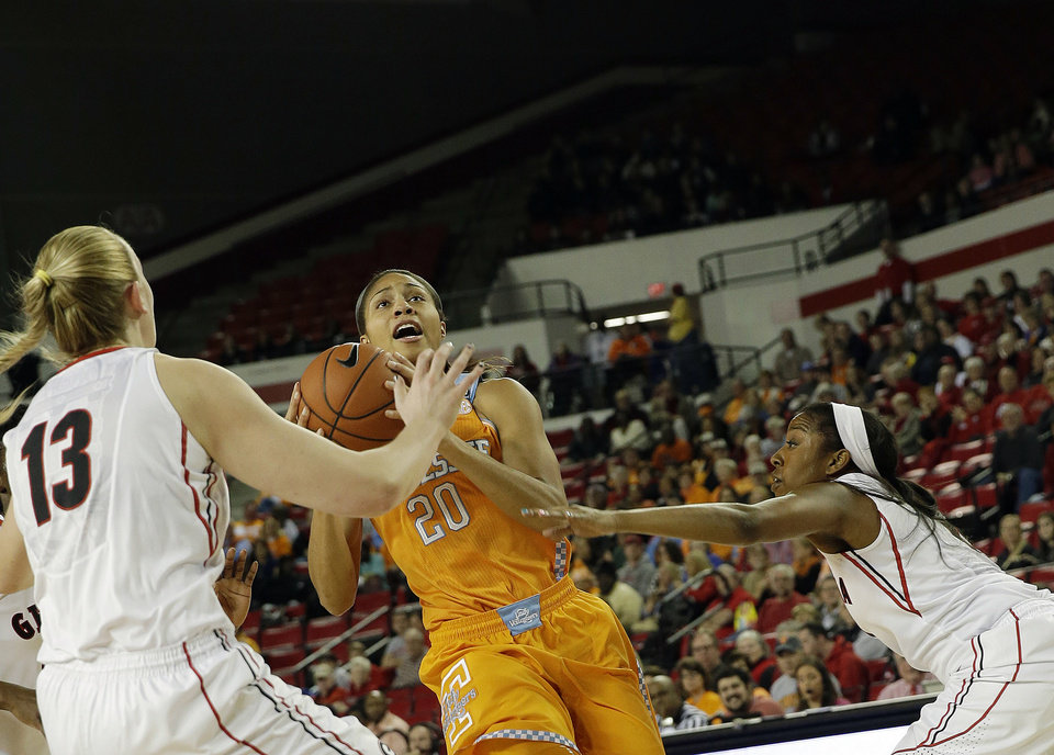 Photo - Tennessee center Isabelle Harrison (20) drives between Georgia forward Merritt Hempe (13) and Georgia guard Tiaria Griffin in the first half of an NCAA college basketball game Sunday, Jan. 5, 2014, in Athens, Ga. (AP Photo/John Bazemore)
