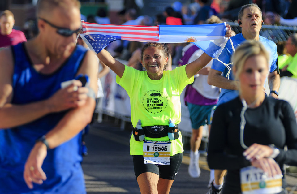 Photo - Graciela Virginia Rosario makes her way to the finish line to complete the half marathon during the Oklahoma City Marathon in Oklahoma City, Okla. on Sunday, April 29, 2018.  . Photo by Chris Landsberger, The Oklahoman