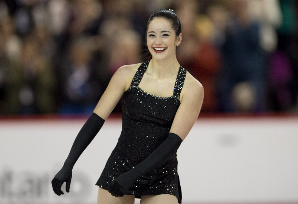Photo - Kaetlyn Osmond smiles after performing her short program at the Canadian figure skating championships Friday Jan. 10, 2014 in Ottawa. (AP Photo/The Canadian Press, Adrian Wyld)