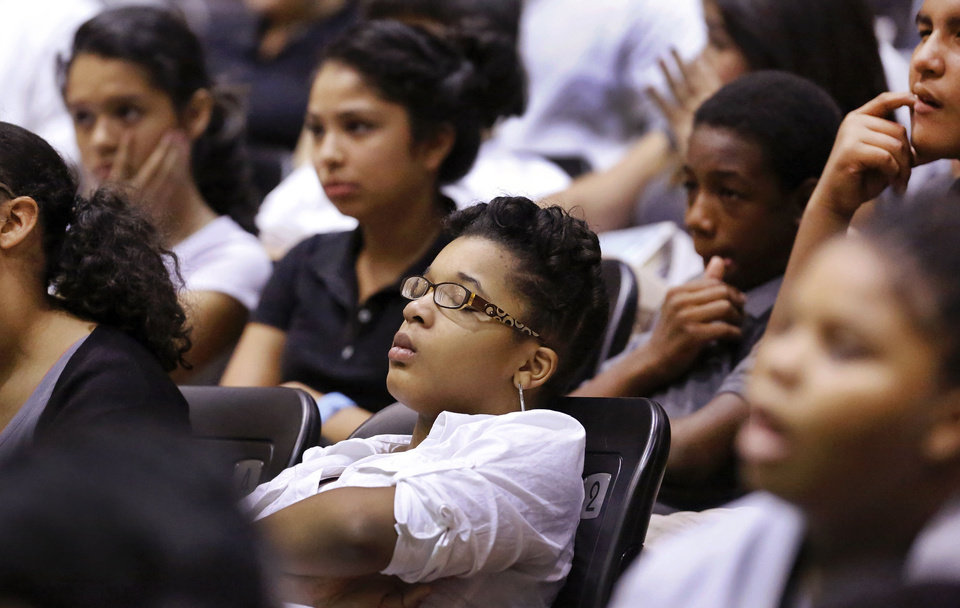 Photo - A student leans back against her seat, closes her eyes and listens to author Susan Bosak's presentation about dreaming. PHOTO BY JIM BECKEL, THE OKLAHOMAN  Jim Beckel - THE OKLAHOMAN