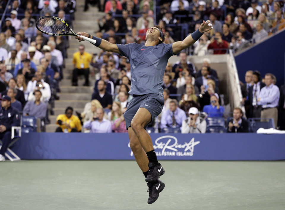 Photo - FILE - In this Sept. 9, 2013, file photo, Rafael Nadal, of Spain, reacts after defeating Novak Djokovic, of Serbia, during the men's singles final of the 2013 U.S. Open tennis tournament. Nadal will not defend his title at the U.S. Open because of an injured right wrist. Nadal and the tournament announced his withdrawal Monday, Aug. 18, 2014, a week before the year's last Grand Slam tournament begins. (AP Photo/Peter Morgan, File)