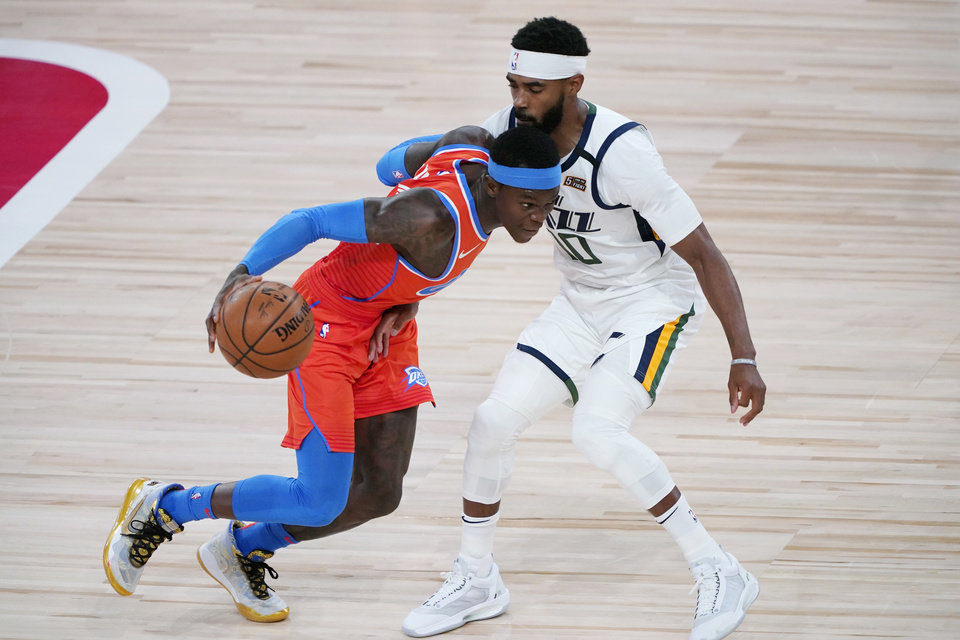 Photo - Aug 1, 2020; Lake Buena Vista, FL, USA; Oklahoma City Thunder's Dennis Schroder, left, drives into Utah Jazz's Mike Conley  during the first half of an NBA basketball game Saturday, Aug. 1, 2020, in Lake Buena Vista, Fla. Mandatory Credit: Ashley Landis/Pool Photo via USA TODAY Sports
