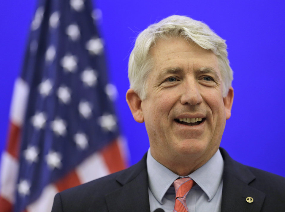 Photo - FILE - Virginia Attorney General-elect Mark Herring smiles during a news conference at the Capitol in Richmond, Va., in this Dec. 18, 2013 file photo. Herring has concluded that the state's ban on gay marriage is unconstitutional and he will no longer defend it in federal lawsuits challenging it, his office said Thursday Jan. 23, 2014. (AP Photo/Steve Helber, File)