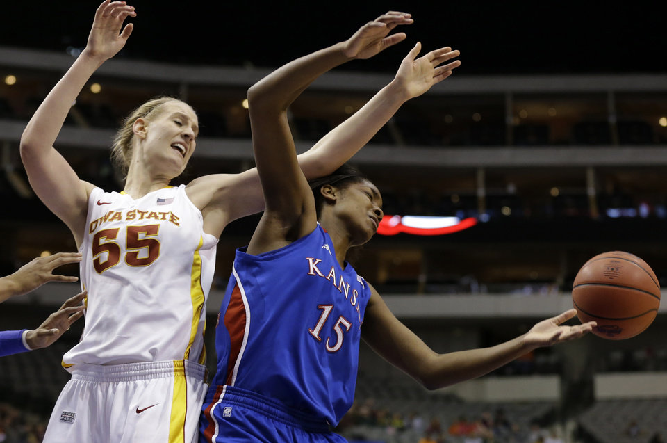 Photo - Iowa State' Anna Prins (55) and Kansas' Chelsea Gardner (15) compete for a rebound in the first half of an NCAA college basketball game in the Big 12 women's tournament on Saturday, March 9, 2013, in Dallas. (AP Photo/Tony Gutierrez)
