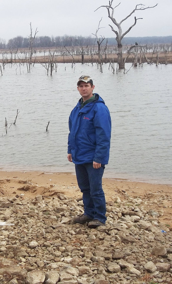 J.J. Dooley, the Lone Chimney Water Association distribution coordinator, stands at the end of a water ramp that is usually submerged. Photo by Ron J. Jackson, Jr.  <strong></strong>