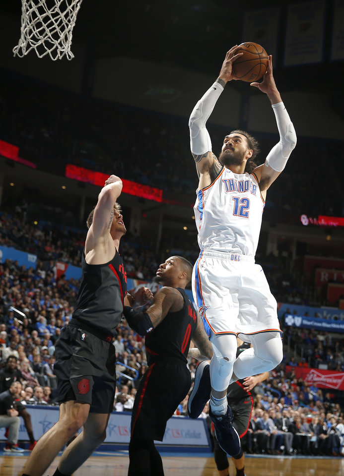 Photo - Oklahoma City's Steven Adams (12) goes up for a basket during the NBA basketball game between the Oklahoma City Thunder and the Portland Trail Blazers at Chesapeake Energy Arena in Oklahoma City, Tuesday, Jan. 22, 2019. Photo by Sarah Phipps, The Oklahoman