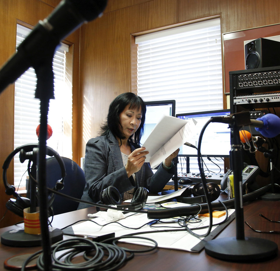 Photo - Above:  Mai Ly Do   has operated a Vietnamese radio station for 12 years. Mai helps keep the Vietnamese community connected, using their native language.  Photo by Jim Beckel,  The Oklahoman  Jim Beckel -  THE OKLAHOMAN