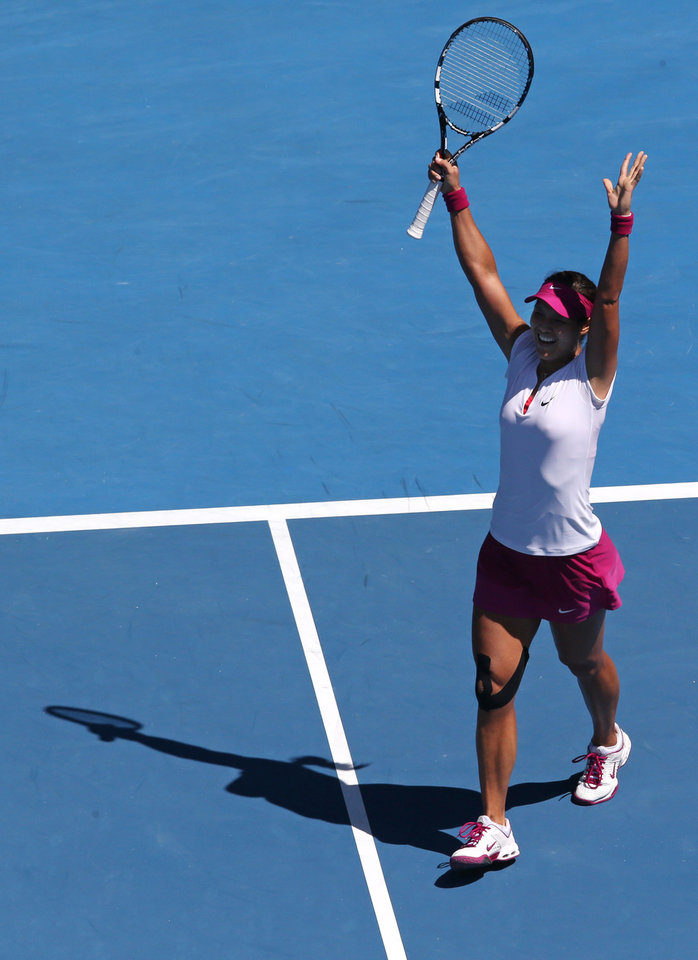 Photo - Li Na of China celebrates after defeating Eugenie Bouchard of Canada during their semifinal at the Australian Open tennis championship in Melbourne, Australia, Thursday, Jan. 23, 2014.(AP Photo/Eugene Hoshiko)