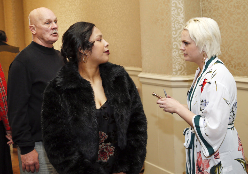 Photo -  Lynde Gleason, with TEEM, at right, talks to Sherrie Holman and Jimmy Little before they start their walks on the runway at TEEM's