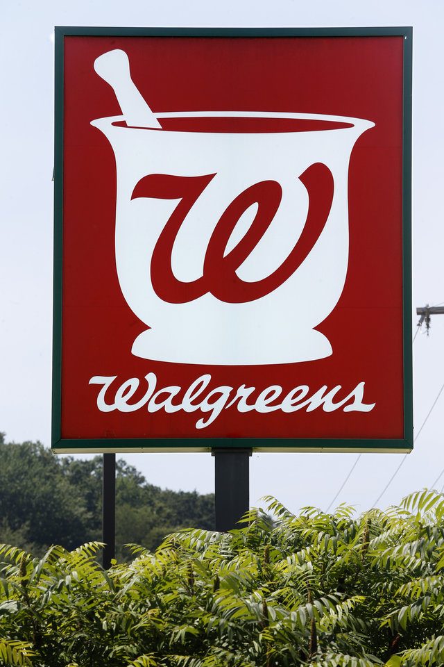 Photo - This Friday, June 21, 2013 photo shows a sign in front of the Walgreens in Wexford, Pa. Walgreen Co. reports quarterly financial results, Tuesday, June 25, 2013. (AP Photo/Keith Srakocic)