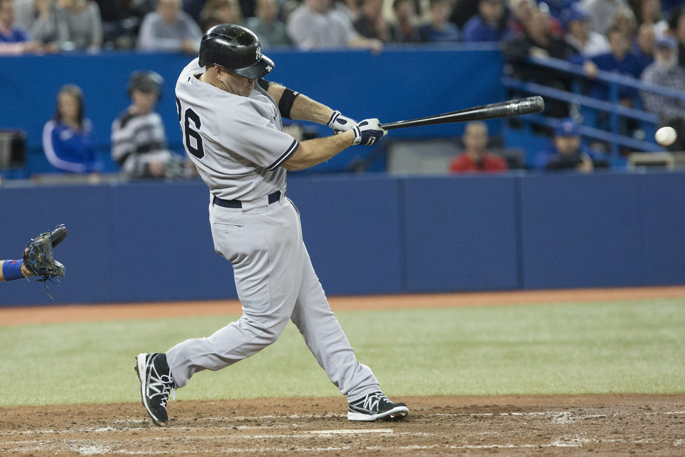 New York Yankee\' Kevin Youkilis hits a two run RBI single off Toronto Blue Jays pitcher Mark Buehrle during the fifth inning of a baseball game in Toronto on Saturday, April 20, 2013. Two runs scored on the hit. (AP Photo/The Canadian Press, Chris Young)