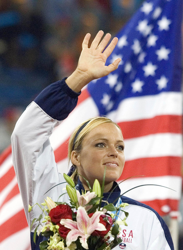 U.S. first baseman Jennie Finch waves to an audience during an award ceremony for the Women's Softball World Championship in Beijing, China, Tuesday, Sept. 5, 2006. The United States blanked Japan 3-0 in their final game. (AP Photo/Ng Han Guan)