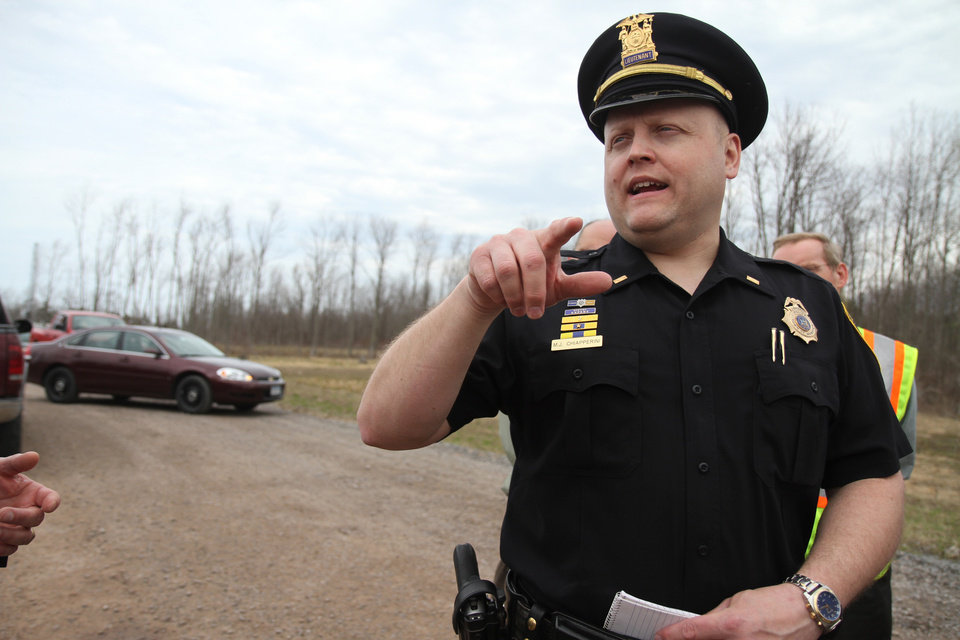 In this photo taken April 11, 2011, Lt. Michael Chiapperini with the Webster Police Department speaks to the media about the accidental death of a man working underground on the Monroe County Water Authority site in Webster, N.Y. on Lake Road near Basket Road. A former convict set a house and car ablaze in his lakeside New York state neighborhood to lure firefighters then opened fire on them, killing two, including Chiapperini, and engaging police in a shootout before killing himself while several homes burned. Authorities used an armored vehicle to evacuate the area. (AP Photo/Democrat & Chronicle, Tina Yee)  MAGS OUT; NO SALES