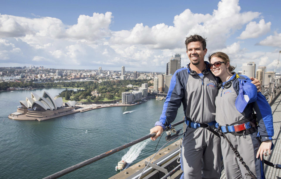 Photo - In this photo released by Destination NSW, Arizona Diamondbacks infielder Cliff Pennington poses with his wife after climbing the Sydney Harbour Bridge in Sydney Thursday, March 20, 2014. The Diamondbacks will play the Los Angeles Dodgers in their Major League Baseball season opening games at the Sydney Cricket Ground on Saturday and Sunday. (AP Photo/Destination NSW, James Horan)
