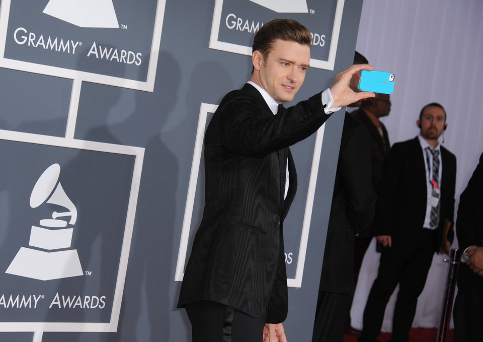 Photo - Musician Justin Timberlake arrives at the 55th annual Grammy Awards on Sunday, Feb. 10, 2013, in Los Angeles.  (Photo by Jordan Strauss/Invision/AP)