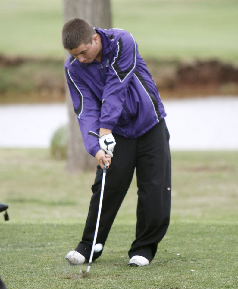 Photo - Anadarko's Austin Hunter tees off during the class 4A boy's state golf tournament at the Lake Hefner Golf Course in Oklahoma City, OK, Monday, May 12, 2014,  Photo by Paul Hellstern, The Oklahoman