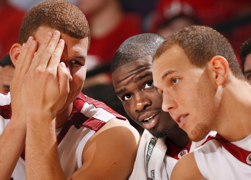 Photo - COLLEGE BASKETBALL: Blake Griffin, Willie Warren and Taylor Griffin watch from the bench as the University of Oklahoma (OU) Sooners defeat the Coppin State Eagles 93-62 at the Lloyd Noble Center in Norman, Okla. on Saturday, January 3, 2009.  Photo by Steve Sisney/The Oklahoman ORG XMIT: kod Photo by Steve Sisney, The Oklahoman