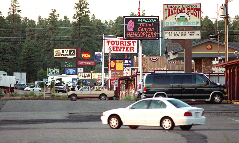 """Photo - File-This August 2009 file photo shows  Tusayan, a tiny town on the road to the Grand Canyon's South Rim. Town officials are thinking that maybe Tusayan isn't the name best suited for this community. They've been floating the idea of changing it to """"The Town of Grand Canyon,"""" """"Grand Canyon South"""" or something similar that reflects its relationship with its nearby neighbor. (AP Photo/Jake Bacon, Arizona Daily Sun,File)"""
