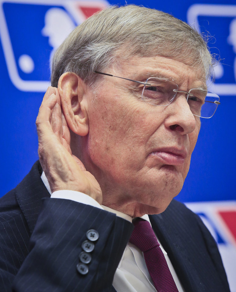 Photo - Baseball Commissioner Bud Selig listens during a press conference, Thursday, May 15, 2014 at Major League Baseball headquarters in New York. Selig, who has headed baseball since 1992 and plans to retire in January 2015, announced that St. Louis Cardinals chairman Bill DeWitt was appointed chairman of a succession committee to determine the process for his replacement.  (AP Photo/Bebeto Matthews)