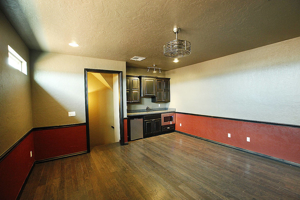 Photo - This upstairs space, complete with kitchenette and cabinetry, could be a kid zone or dad cave in the R&R Homes project house for the Southwest Showcase of Homes.  David McDaniel - The Oklahoman
