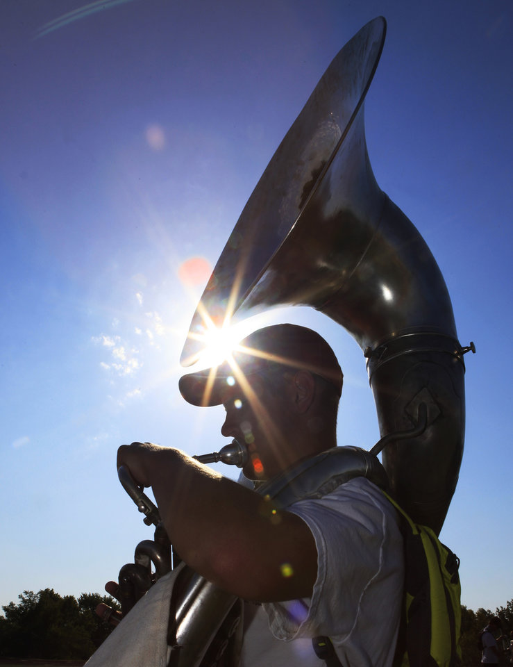 Freshman Daniel Williams plays his tuba during Edmond Memorial's Band Camp Wednesday , August 3, 2011. Photo by David McDaniel, The Oklahoman
