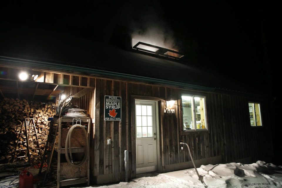 Photo - In this March 13, 2014 photo, steam rises from a roof window of the Turtle Lane Maple sugar house in North Andover, Mass. Maple syrup season is finally under way in Massachusetts after getting off to a slow start because of unusually cold weather. (AP Photo/Elise Amendola)