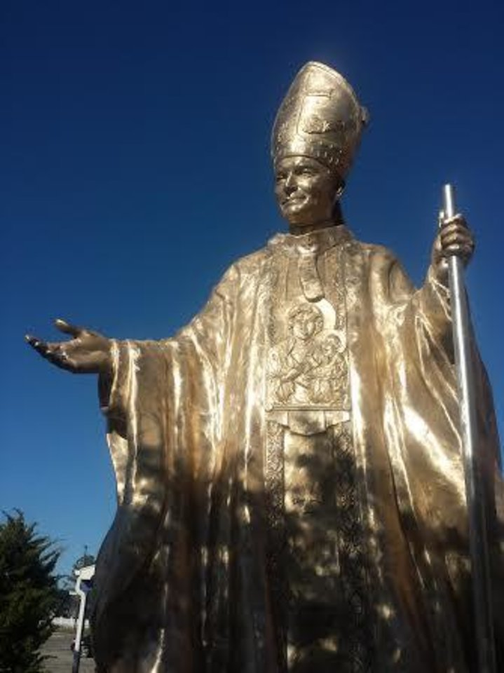 Photo -  A 21-foot-tall statue of Pope John Paul II graces the driveway at The Crucible in Norman, where it was forged. [PHOTO PROVIDED]