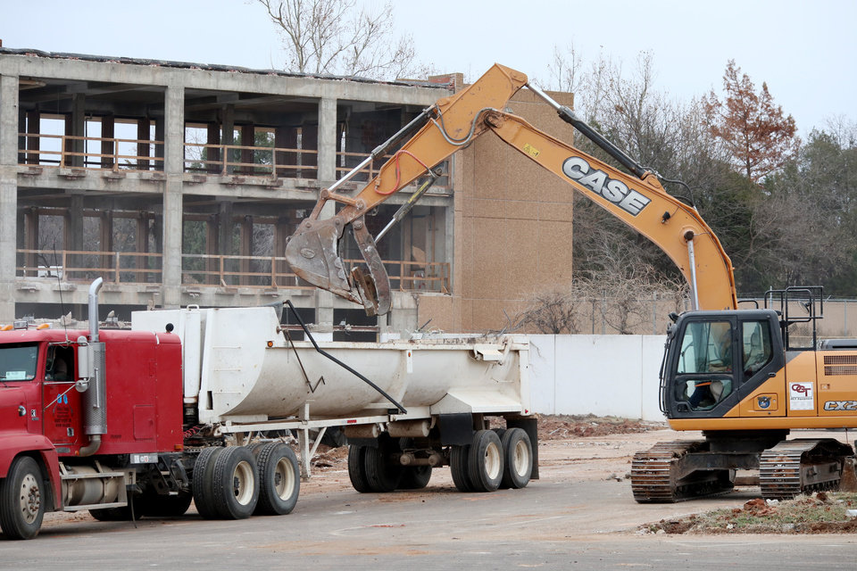 Photo -  Rubble from demolition of the former Oklahoma Wildlife Building is collected Thursday to be hauled away. [Photo by Doug Hoke, The Oklahoman]