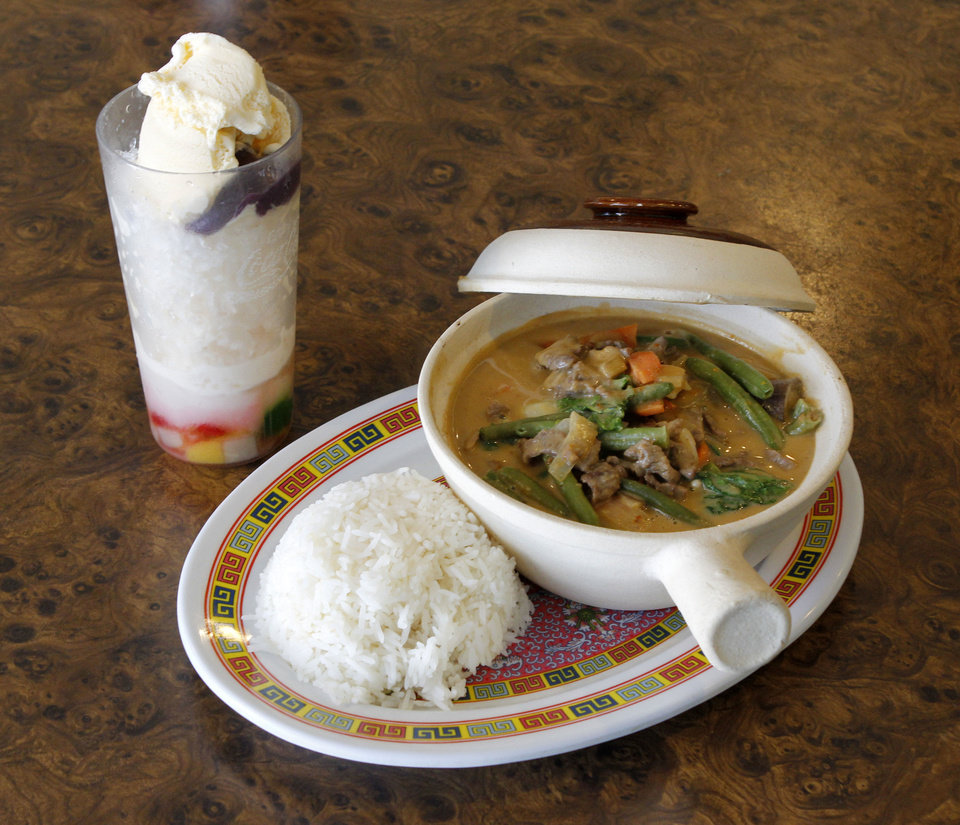 This is the Filipino dish kare-kare, served with glutinous rice at Evelyn's Asian Table in Oklahoma City. The dessert drink is called halo-halo. <strong>PAUL HELLSTERN - Oklahoman</strong>