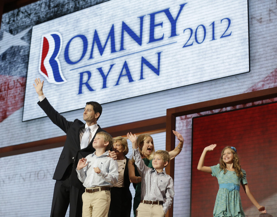Republican vice presidential nominee, Rep. Paul Ryan, joined by his family, from left, Charlie, mother Betty Ryan Douglas, wife Janna, Sam and Liza, waves after his acceptance speech during the Republican National Convention in Tampa, Fla., on Wednesday, Aug. 29, 2012. (AP Photo/Charles Dharapak)
