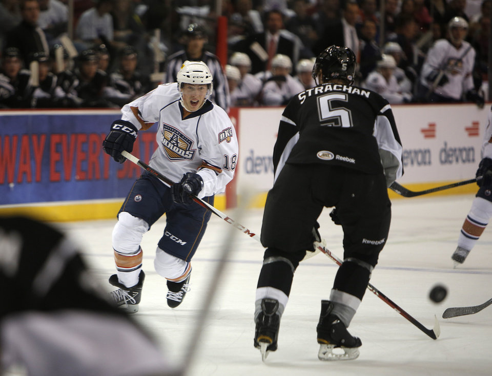 AHL HOCKEY: Oklahoma City\'s Ryan Nugent-Hopkins (18) takes a shot against San Antonio during a game between the Oklahoma City Barons and the San Antonio Rampage at the Cox Convention Center in Oklahoma City, Friday, Oct. 19, 2012. Photo by Garett Fisbeck, The Oklahoman