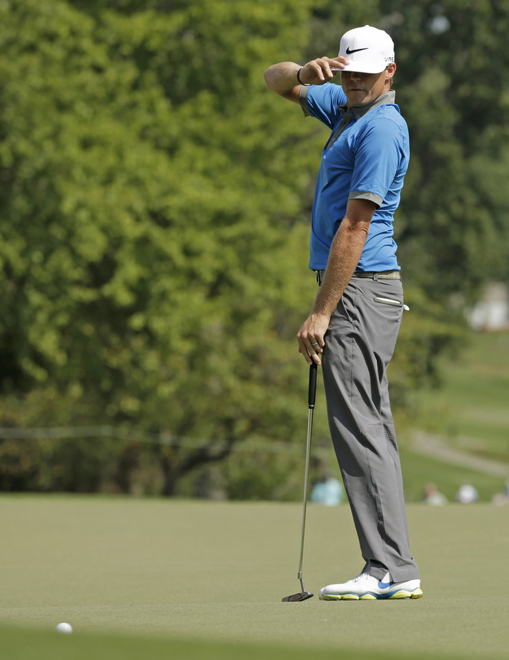 Photo - Nick Watney reacts after missing a birdie putt on the ninth hole during the third round of the Wyndham Championship golf tournament in Greensboro, N.C., Saturday, Aug. 16, 2014. (AP Photo/Chuck Burton)