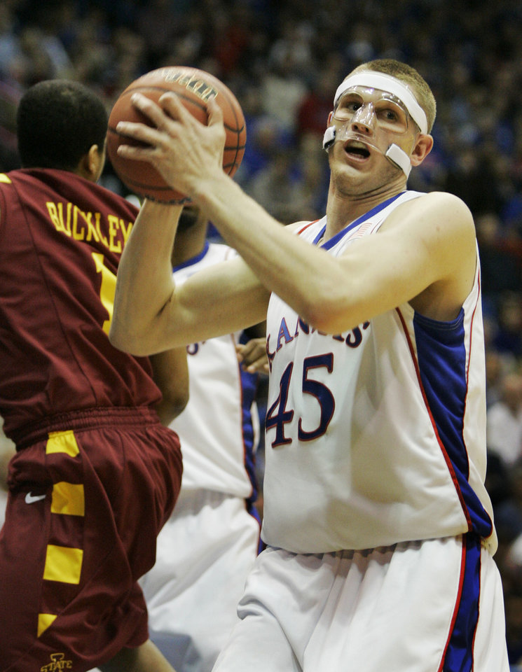 Photo - University of Kansas center Cole Aldrich (45) clears a rebound next to Iowa State guard Dominique Buckley (1) during the first half of their NCAA college basketball game in Lawrence, Kan., Wednesday, Feb. 18, 2009. Aldrich scored 22 points in Kansas' 72-55 win over Iowa State. (AP Photo/Orlin Wagner) ORG XMIT: KSOW109