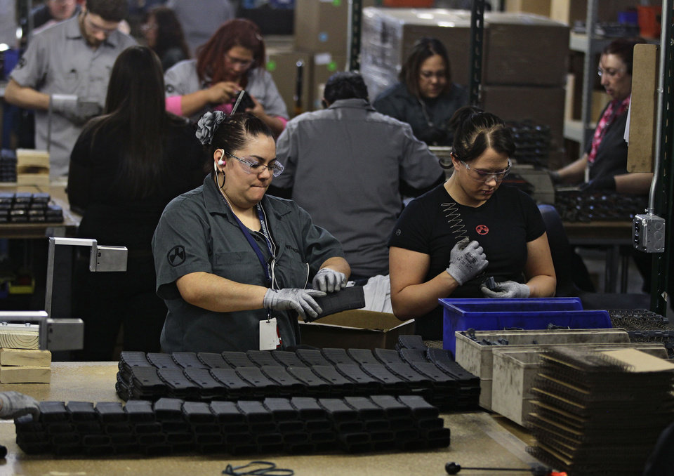 In this Feb. 28, 2013 photo, workers assemble 30-round capacity ammunition magazines for high-velocity rifles, inside the Magpul Industries plant in Erie, Colo. Magpul founder and president Richard Fitzpatrick has threatened to pull his company out of Colorado should state lawmakers pass a bill restricting the size of ammunition magazines. (AP Photo/Brennan Linsley)