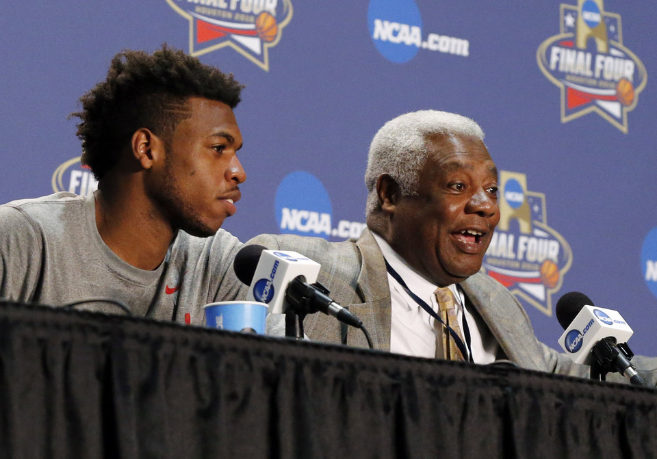 Photo - Oklahoma's Buddy Hield (24), left, listens as Oscar Robertson speaks during the announcement that Hield won the U.S. Basketball Writers Association's Oscar Robertson Trophy at Final Four Friday before the national semifinal between the Oklahoma Sooners and the Villanova Wildcats in the NCAA Men's Basketball Championship at NRG Stadium in Houston, Friday, April 1, 2016. OU will play Villanova in the Final Four on Saturday. Photo by Nate Billings, The Oklahoman