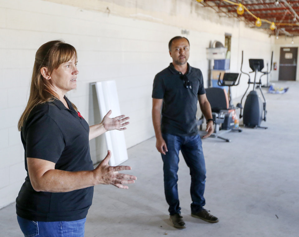 Photo -  Vicki Langford, CEO of Project 3810, talks about the office-warehouse incubator space with partner Shawn Wright. [PHOTO BY NATE BILLINGS, THE OKLAHOMAN]