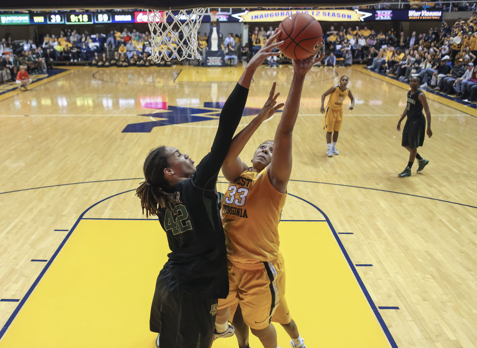 Photo - Baylor's Brittney Griner (42) blocks the shot of West Virginia's Ayana Dunning (33) during the second half of an NCAA college basketball game at WVU Coliseum in Morgantown, W.Va., on Saturday, March 2, 2013. Baylor won 80-49. (AP Photo/David Smith)