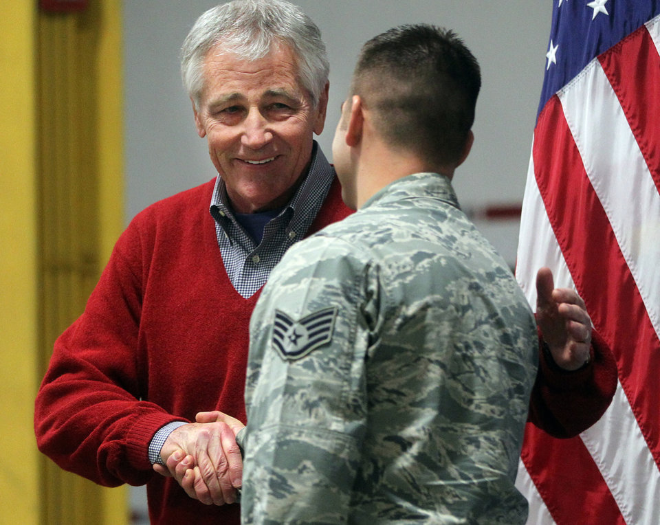 Photo - Defense Secretary Chuck Hagel greets an airman from the 20th Air Force 90th Missile Wing during a trip to F.E. Warren Air Force Base on Thursday, Jan. 9, 2014 in Cheyenne, Wyo. It was the first time since 1982 that a defense secretary has visited the nuclear missile base. (AP Photo/Wyoming Tribune Eagle, Blaine McCartney)